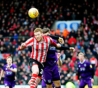 Lincoln City's Cian Bolger vies for possession with Grimsby Town's Harry Cardwell<br /> <br /> Photographer Andrew Vaughan/CameraSport<br /> <br /> The EFL Sky Bet League Two - Lincoln City v Grimsby Town - Saturday 19 January 2019 - Sincil Bank - Lincoln<br /> <br /> World Copyright © 2019 CameraSport. All rights reserved. 43 Linden Ave. Countesthorpe. Leicester. England. LE8 5PG - Tel: +44 (0) 116 277 4147 - admin@camerasport.com - www.camerasport.com