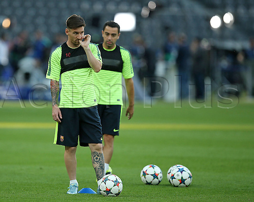05.06.2015. Berlin, Germany. Lionel Messi (FC Barcelona) trains ahead of the Champions League final between Juventus and Barcelona with team mate Xavi (FC Barcelona)