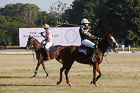 Players from the Australian team and Jaipur team pass each other during a game between the Royal Jaipur Polo Team (in pink) and the Western Australia Polo Team (in black) for the Argyle Pink Diamond Cup, organised as part of the 2013 Oz Fest in the Rajasthan Polo Club grounds in Jaipur, Rajasthan, India on 10th January 2013. Photo by Suzanne Lee