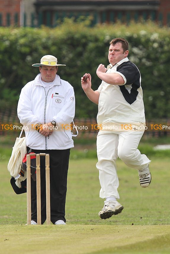 A Crane in bowling action for Noak Hill - Noak Hill Taverners CC vs Barking CC 2nd XI - Essex Cricket League - 19/05/12 - MANDATORY CREDIT: Gavin Ellis/TGSPHOTO - Self billing applies where appropriate - 0845 094 6026 - contact@tgsphoto.co.uk - NO UNPAID USE.