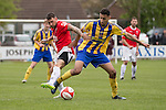 © Joel Goodman - 07973 332324 . 25/04/2015 . Salford , UK . Salford's Scott Burton challenges for the ball . Evostick League champions , Salford FC , play Osset Town , in Salford . Photo credit : Joel Goodman