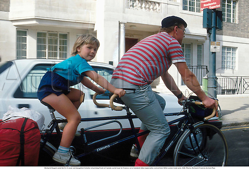 Richard Rogers and his 51/2 year old daughter Estelle returning from a 3 week cycle tour in France, on a tandem bike especially converted. Wife Lynne rode solo. 840. Photo: Richard Francis/Action Plus...1984.leisure.cycling.bike.bicycle.tandem bike.child.family.leisure activities.pastime pastimes.recreation recreational.cycling bike riding cycle