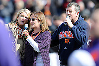 Doug Jones of the Greenville-based band Cravin' Melon, and his sisters sing the National Anthem before the Reedy River Rivalry game between the Clemson Tigers and South Carolina Gamecocks on Saturday, February 28, 2015, at Fluor Field at the West End in Greenville, South Carolina. South Carolina won, 4-1. (Tom Priddy/Four Seam Images)