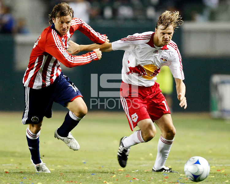 Chivas USA midfielder, Carey Talley(12) and NY Red Bulls midfielder, Dave van den Bergh(11) battle for the ball during the 1st half. Chivas USA  took on the NY Red Bulls on June 28, 2008 at the Home Depot Center in Carson, CA. The game ended in a 1-1 tie.