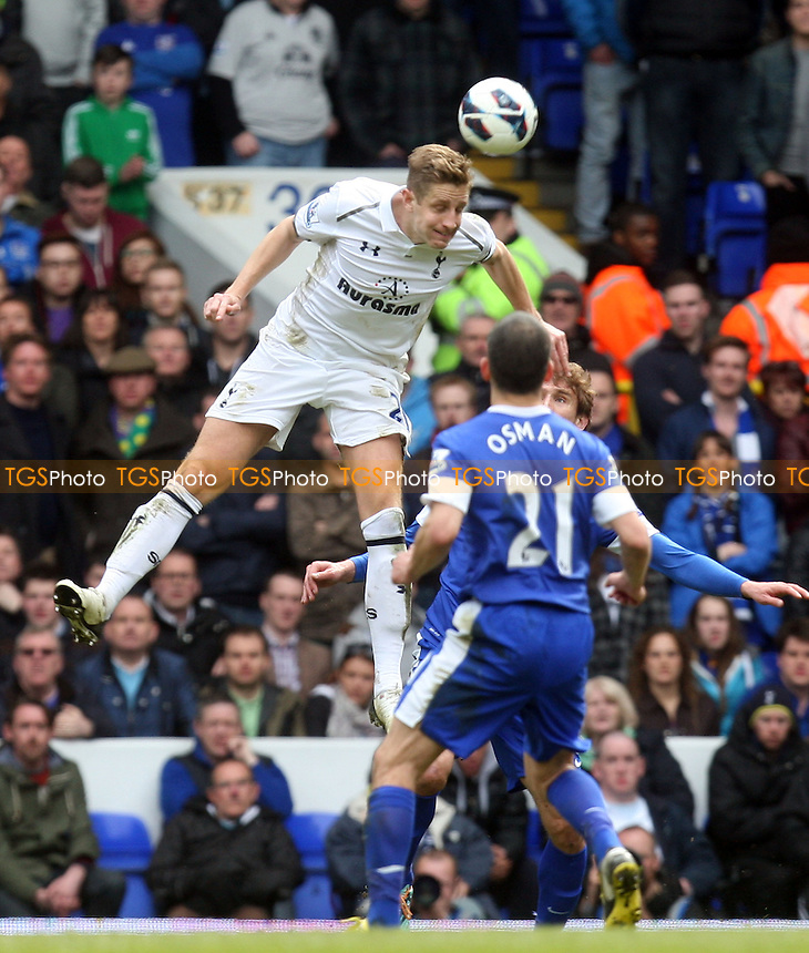Michael Dawson of Tottenham Hotspur and Leon Osman of Everton - Tottenham Hotspur vs Everton at the White Hart Lane Stadium - 07/04/13 - MANDATORY CREDIT: Dave Simpson/TGSPHOTO - Self billing applies where appropriate - 0845 094 6026 - contact@tgsphoto.co.uk - NO UNPAID USE.