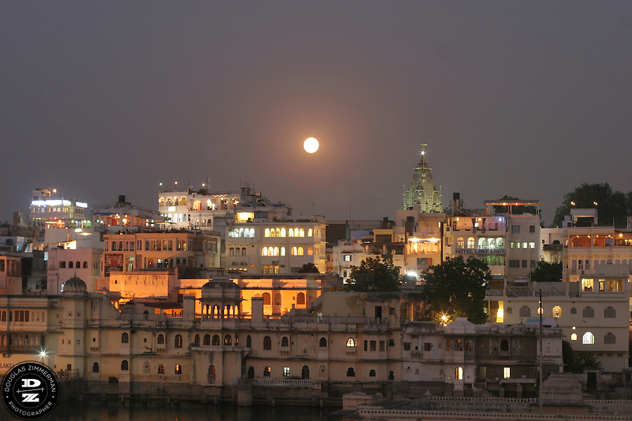 """A full moon rises over Udaipur, Rajasthan, India.  Udaipur is located in a valley surrounded by the Aravalli hills, and at its center is the Pichola Lake.  The scenic city has been described as """"the most romantic spot on the continent of India"""" (by Colonel James Tod).  Photograph by Douglas ZImmerman"""