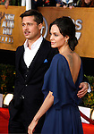 LOS ANGELES, CA. - January 25: Actress Angelina Jolie and actor Brad Pitt arrive at the 15th Annual Screen Actors Guild Awards held at the Shrine Auditorium on January 25, 2009 in Los Angeles, California.