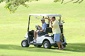 United States President Barack Obama and Bobby Titcomb enjoy a quiet moment as they approach the 18th hole during a round of golf with friends Marvin Nicholson and Eric Whitaker at Mid Pacific Country Club, Kailua, Hawaii on Monday, December 23, 2013.  The first family is enjoying holiday vacation in Hawaii until January 5, 2014. <br /> Credit: Cory Lum / Pool via CNP