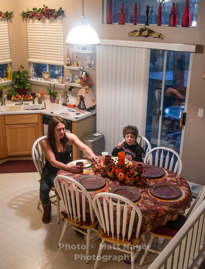 MMA fighter Cat Zingano (cq) and her son, Brayden Zingano (cq, age 8) eat breakfast and prepare for a football game in Westminster, Colorado, Saturday, November 8, 2014. In 2013, Zingano became the first woman to win a UFC fight by technical knockout and is currently the number three ranked pound-for-pound female MMA fighter in the world.<br /> <br /> Photo by Matt Nager