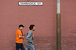 Fans making their way along Tannadice Street, Dundee towards Tannadice Park, home of Dundee United on the day they played host to Dunfermline Athletic in a Scottish Premier League match. The visitors won the game by one goal to nil, watched by a crowd of 6,527. Dundee United's stadium was situated on the same street as their city rival Dundee, whose Dens Park ground was situated a few hundred yards away.