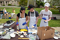 Team Kitchen Nightmares<br /> Six student teams battle to win the Iron Chef competition as part of Earth Month on Thursday, April 11, 2019 in the JSC Quad. Event MC, Amos Himmelstein, provided play-by-play of the action. Their task was to create the best vegetarian or vegan starter and sauté dishes. A wide variety of fresh organic produce (some freshly picked at the FEAST garden), FEAST eggs, spices, oils AND one secret ingredient were at the team's disposal.<br /> Chef Brad Kent, owner of Olio GCM Wood Fired Pizzeria at Grand Central Market and co-Founder/chief culinary officer for Blaze Pizza, is this year's guest judge.<br /> The contest is led by FEAST and supported by Campus Dining, Facilities Management, RESF, and the Office of the President.<br /> (Photo by Marc Campos, Occidental College Photographer)