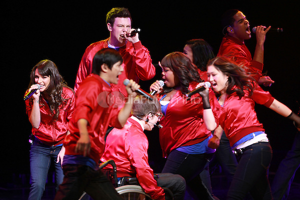 Lea Michele, Cory Monteith, Kevin McHale, Amber Riley and Jenna Ushkowitz performing at the Glee Concert Tour. The Gibson Amphitheatre at Universal City Walk in Los Angeles, California. May 20, 2010.Credit: Dennis Van Tine/MediaPunch