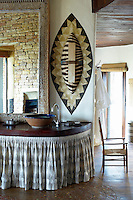 A stone basin on a wood unit in a guest bathroom at Singita Pamushana Lodge, Malilongwe Trust, Zimbabwe