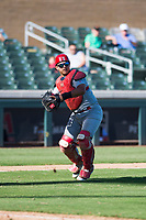 Surprise Saguaros catcher Jeremy Martinez (4), of the St. Louis Cardinals organization, prepares to make a throw to first base during an Arizona Fall League game against the Salt River Rafters at Salt River Fields at Talking Stick on November 5, 2018 in Scottsdale, Arizona. Salt River defeated Surprise 4-3 . (Zachary Lucy/Four Seam Images)