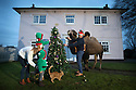 18/12/16<br /> <br /> L/R: Charlotte Anderson-Dixon, 34, Reuben Anderson-Dixon, 6, Sol Anderson-Dixon, 2, and Nathan Anderson-Dixon, 38.<br /> <br /> <br /> It's a festive tradition that will be carried out in millions of homes this Christmas - the annual family photo, often including a much-loved cat or dog - but when one of your pets is a 9ft camel weighing more than 2,000lbs it's a challenge to capture the perfect picture!<br /> <br /> But for this family living Pasturefields, Staffordshire, their camel, Joe is an old-hand at posing for the camera, after all he has taken centre-stage in many films and TV adverts.<br /> <br /> And Nathan Anderson-Dixon, who owns The Animal Company, said the double-humped ungulate behaved impeccably, even managing to place his own bauble in the Christmas tree branches.<br /> <br /> <br /> All Rights Reserved F Stop Press Ltd. (0)1773 550665   www.fstoppress.com