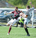 Stenny's Colin McMenamin and Queens Park's Tony Quinn challenge for the ball.