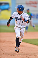 Asheville Tourists shortstop Jose Gomez (4) runs to third base during a game against the Lexington Legends at McCormick Field on May 29, 2017 in Asheville, North Carolina. The Legends defeated the Tourists 6-2. (Tony Farlow/Four Seam Images)