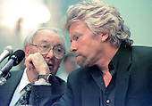 Washington, DC - June 4, 1997 - Sir Freddie Laker, left, and Richard Branson, right, discuss the testimony as they appear on a panel before the United States Senate Commerce, Science and Transportation Subcommittee hearing on the US - Britain aviation negotiations.  <br /> Credit: Ron Sachs / CNP