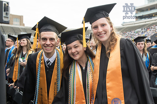 May 21, 2017; Graduates celebrate during the 2017 Commencement ceremony in Notre Dame Stadium.  (Photo by Barbara Johnston/University of Notre Dame)
