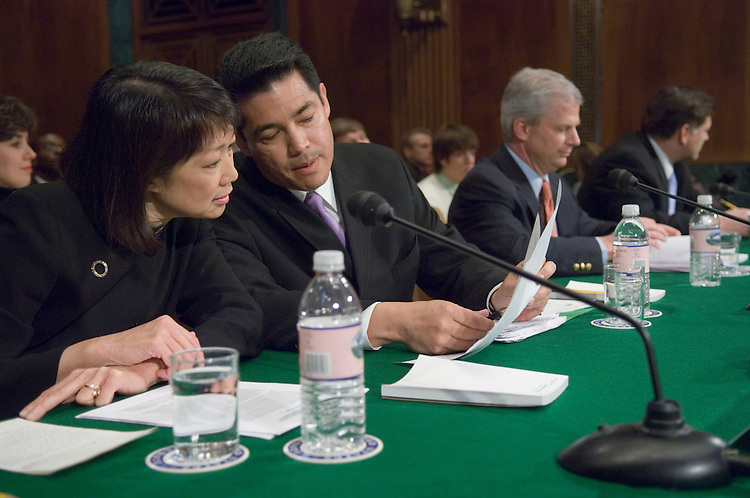 03/06/07--Carol Lam, David C. Iglesias, John McKay, and H.E. Cummins III, former U.S. attorneys who were asked to resign last year by the Bush administration, before the Senate Judiciary hearing on their dismissals. Both the House and Senate Judiciary panels are investigating the dismissal of eight U.S. attorneys and their replacement by interim appointees who can serve indefinitely and do not require Senate confirmation. Democrats want to repeal that authority, created by a provision in the reauthorization (PL 109-177) last year of the 2001 anti-terrorism law known as the Patriot Act. Aside from seeking to gain support for repeal legislation (HR 580, S 214), the panels are probing allegations of misconduct by members of Congress. Rep. Heather A. Wilson and Sen. Pete V. Domenici, who are New Mexico Republicans, have both admitted contacting one of the eight prosecutors about public corruption investigations. The attorneys told the Senate Judiciary Committee that the Justice Department pressured them not to speak publicly about their dismissals. Justice Department spokesman Brian Roehrkasse said that assertion was Òridiculous and not based on fact.Ó Congressional Quarterly Photo by Scott J. Ferrell