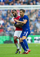 Arsenal's Alexandre Lacazette and Chelsea's Cesc Fabregas  during the The FA Community Shield Final match between Arsenal and Chelsea at Wembley Stadium, London, England on 6 August 2017. Photo by Andrew Aleksiejczuk / PRiME Media Images.