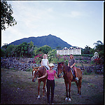 "Evening horseback riding at The Hermitage Plantation Inn, Nevis.  Views of the ""Manor House Villa"" and Mt. Nevis in the background."
