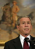 "Washington, D.C. - December 17, 2005 -- United States President George W. Bush uses his weekly radio address from the Roosevelt Room of the White House on Saturday, December 17, 2005 to confirm that he secretly signed an order authorizing the National Security Agency (NSA) to eavesdrop on the international communications of Americans and other domestic residents with known links to al Qaeda. He defended his decision, calling the program a ""vital tool in our war against terrorists"" and ""critical to saving American lives."" He said the program is reviewed every 45 days by the attorney general and White House counsel and that he has to reauthorize it. He has reauthorized it 30 times so far, he said, and ""I intend to do so for as long as our nation faces a threat"" from al Qaeda. Without naming any, he also criticized news organizations for divulging the program, saying the disclosure ""damaged our national security.""   The confirmation came as part of an unusually long, live radio address broadcast from the Roosevelt Room. The address lasted nearly 10 minutes and started out with a warning to the United States Senate to end the filibuster against the USA Patriot Act and approve it. He accused Senate Democrats, who are blocking reauthorization of the law, of putting Americans in danger.  ""That decision is irresponsible and it endangers the lives of our citizens. The senators who are filibustering must stop their delaying tactics."" Noting that the act expires in two weeks, he said, ""The terrorist threat to our country will not expire in two weeks.""<br /> Credit: Martin H. Simon - Pool via CNP"