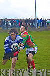 Adrian O'Connell of St Michaels Foilmore breaks down another Renard attack from Brendan Casey.