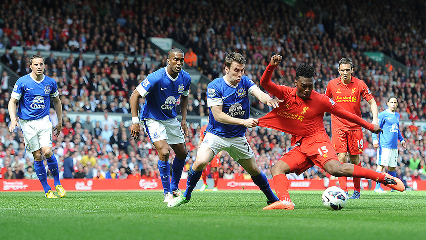 Everton's Seamus Coleman grabs the shirt of Liverpool's Daniel Sturridge as the forward prepares to shoot.. - (Photo by Stephen White/CameraSport) - ..Football - Barclays Premiership - Liverpool v Everton - Sunday 5th May 2013 - Anfield - Liverpool..© CameraSport - 43 Linden Ave. Countesthorpe. Leicester. England. LE8 5PG - Tel: +44 (0) 116 277 4147 - admin@camerasport.com - www.camerasport.com