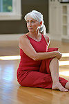 Mature woman exercising, looking away