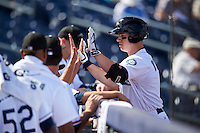 Peoria Javelinas Tyler O'Neill (11), of the Seattle Mariners organization, high fives teammates after hitting a home run during a game against the Surprise Saguaros on October 12, 2016 at Peoria Stadium in Peoria, Arizona.  The game ended in a 7-7 tie after eleven innings.  (Mike Janes/Four Seam Images)