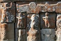 close up of Eflatun Pınar ( Eflatunpınar) Ancient Hittite relief sculpture monument and sacred pool, and its Hittite relief scultures of Hittite gods.  Between 15th to 13th centuries BC. Lake Beysehir National Park, Konya, Turkey.