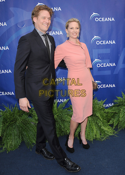 James Tupper &amp; Anne Heche<br /> 6th Annual Oceana SeaChange Gala held at a Private Villa, Laguna Beach, California, USA.     <br /> August 18th, 2013<br /> full length pink dress clutch bag gold black shoes suit couple <br /> CAP/DVS<br /> &copy;DVS/Capital Pictures