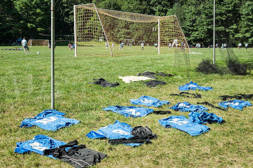 Soccer jerseys lay out to dry between games at a soccer tournament.