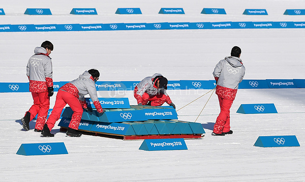 Helpers preparing the first training runs in the Alpensia Biathlon Centre in Pyeongchang, South Korea, 07 February 2018. The Pyeongchang 2018 Winter Olympics take place between 09 and 25 February. Photo: Hendrik Schmidt/dpa-Zentralbild/dpa /MediaPunch ***FOR USA ONLY***