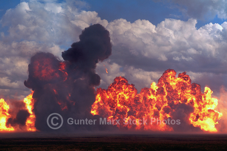 Fireball Explosions on Ground, with Billowing Black Smoke and Intense Flames