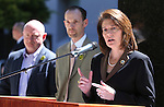 From left, Mark Kelly, the husband of former Rep. Gabrielle Giffords and Nevada Sen. Justin Jones, D-Las Vegas, listen as Attorney General Catherine Cortez Masto speaks at a press conference in front of the Legislative Building, in Carson City, Nev., on Friday, May 31, 2013. <br /> Photo by Cathleen Allison