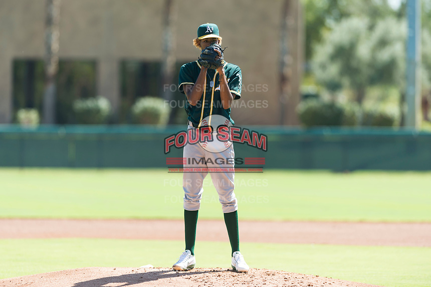 Oakland Athletics relief pitcher Wilkin Ramos (50) looks in for the sign during an Instructional League game against the Los Angeles Dodgers at Camelback Ranch on September 27, 2018 in Glendale, Arizona. (Zachary Lucy/Four Seam Images)