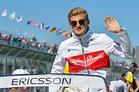 March 25, 2018: Marcus Ericsson (SWE) #9 from the Alfa Romeo Sauber F1 Team waves to the crowd during the drivers' parade at the 2018 Australian Formula One Grand Prix at Albert Park, Melbourne, Australia. Photo Sydney Low