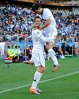 Valter Birsa (left) of Slovenia celebrates his goal with team-mate Aleksander Radosavljevic (right). USA tied Slovenia 2-2 in the 2010 FIFA World Cup at Ellis Park in Johannesburg, South Africa on June 18th, 2010.