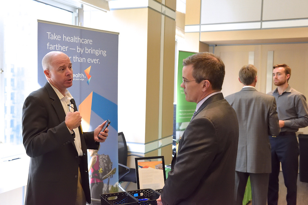 Attendees networking at a healthcare conference.