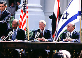 President Anwar Sadat of Egypt, United States President Jimmy Carter, and Prime Minister Menachem Begin of Egypt sign the Camp David Peace Treaty on the North Lawn of the White House on March 26, 1979..Credit: Arnie Sachs / CNP