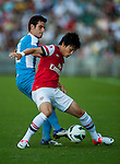 Ryo Miyaichi of Arsenal FC and Jordi Tarres of Kitchee in action during the pre-season Asian Tour friendly match at the Hong Kong Stadium on July 29, 2012. Photo by Victor Fraile / The Power of Sport Images