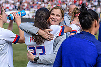 CHICAGO, IL - OCTOBER 06: Christen Press #23 and Jill Ellis of the United States during a game between the USA and Korea Republic at Soldier Field, on October 06, 2019 in Chicago, IL.