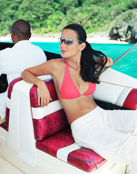BORACAY ISLAND, PHILIPPINES : Filipina model Bianca Araneta rides in a Nami Resort Boat.  Boracay Island, Philippines, South East Asia.