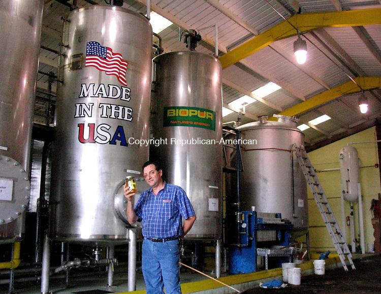BETHLEHEM, CT-  31 August 2007-083107GK01-- Christos Glynos holds a jar of soybean diesel fuel, produced at his Bethlehem farm.  George Krimsky Republican-American