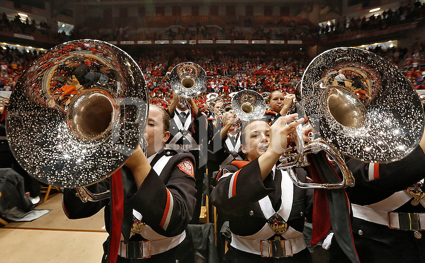 With their instruments beaded with rain drops Ohio State University Marching Band members Jackie Schilling and Julie Pickard play at the Skull Session at St John Arena on October 19, 2013. ( left to right)  (Chris Russell/Dispatch Photo)