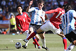 17 JUN 2010: Gonzalo Higuain (ARG) (9) and Lee Jung Soo (KOR) (14). The Argentina National Team defeated the South Korea National Team 4-1 at Soccer City Stadium in Johannesburg, South Africa in a 2010 FIFA World Cup Group E match.