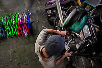A bicycle worker works on a bench drilling machine in a small scale bicycle factory in Bogota, Colombia, 10 April 2013. Due to the strong, vibrant cycling culture in Colombia, with cycling being one of the two most popular sports in the country, dozens of bike workshops and artisanal, often family-run bicycle factories were always spread out through the Colombian cities. However, growing import of cheap bicycles and components from China during the last decade has led to a significant decline in domestic bicycle production. Traditional no-name bike manufacturers are forced to close down their factories, struggling to survive in the competitive bicycle market.