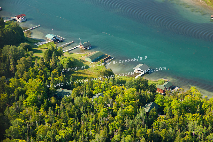 boathouses of Les Cheneaux Club on Marquette Island side of Snows Channel across from golf course in Les Cheneaux Area of Lake Huron near Cedarville, MI